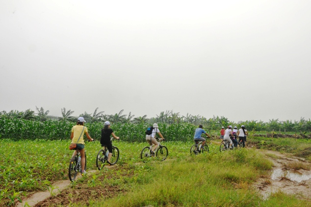 Cycling to Bat Trang Pottery Village